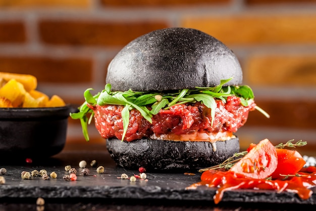 Black bun burger with the words meat