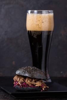 Black burger with dark beer
