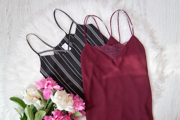 Black and burgundy t-shirt, peonies on white fur.