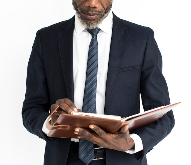 Black business man reading journal portrait