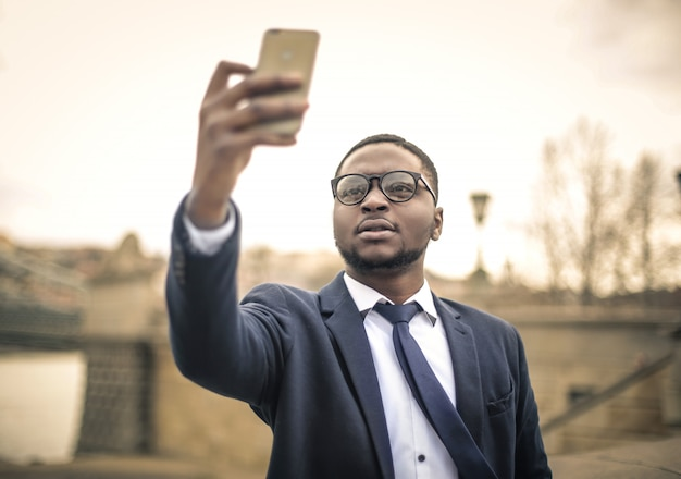 Black businessman taking a picture
