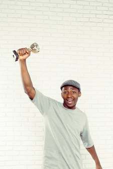 Black businessman with trophy