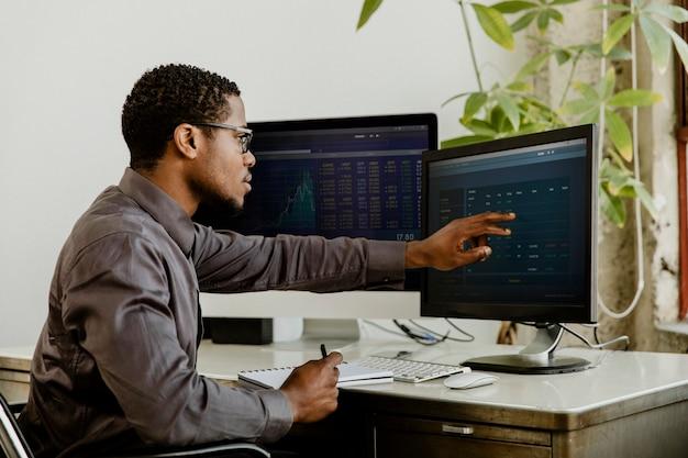 Black businessman working on a computer