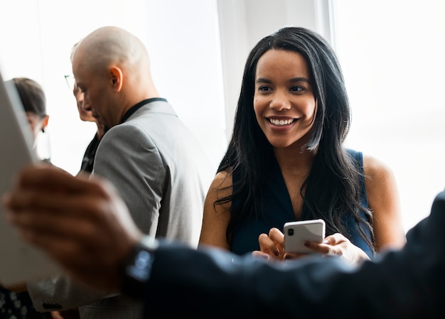 Black businesswoman using a mobile phone