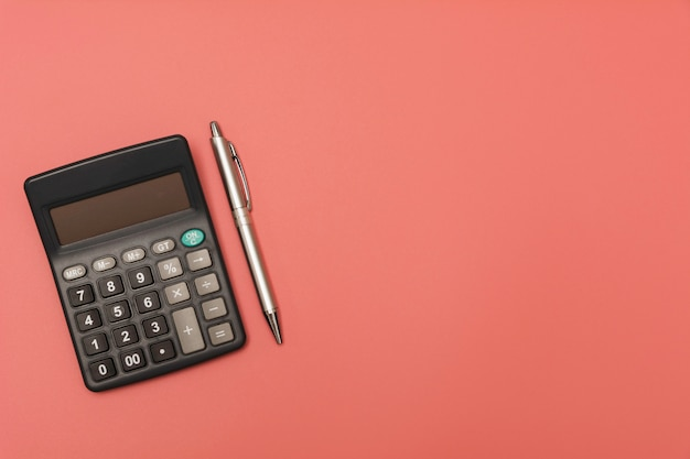 Black calculator with pen and copy space.