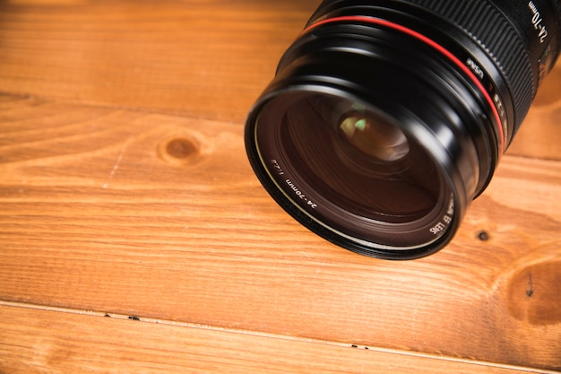 Black camera lens on the table