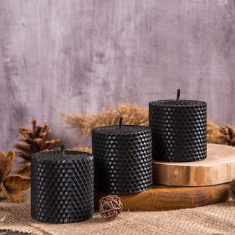 Black candles are handmade, an unusual element of the interior.