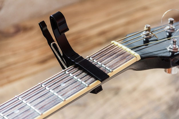 Black capo on a guitar