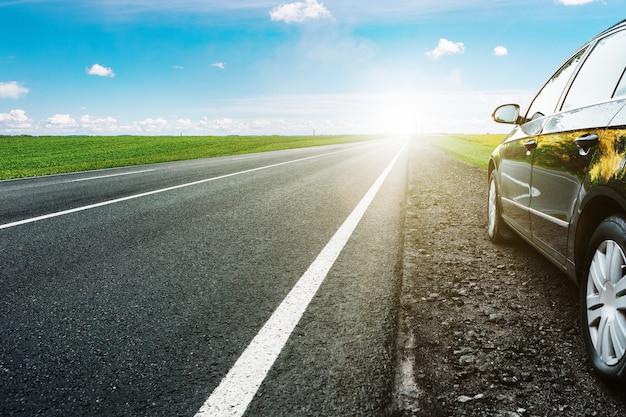 Black car on asphalt road
