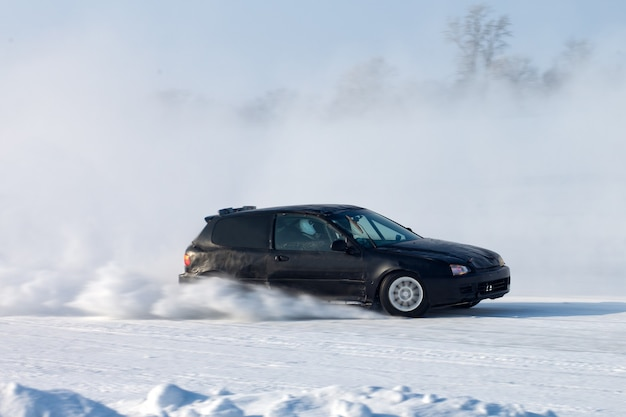 Black car moving on ice with blured background