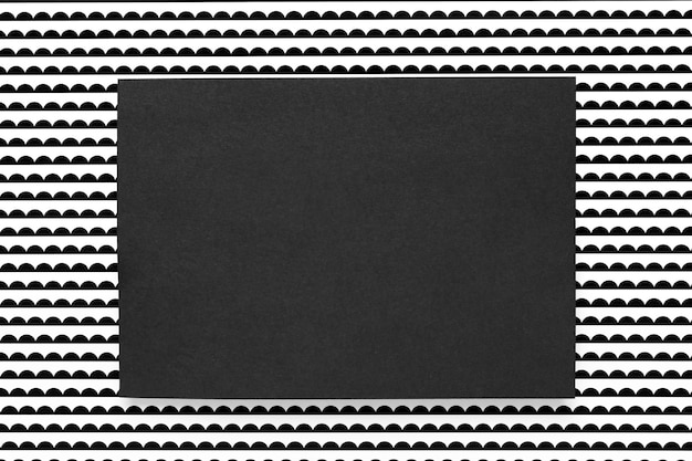 Black card on patterned background
