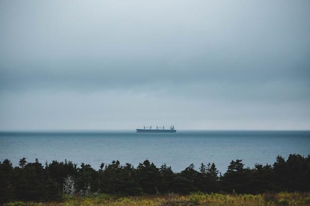 Black cargo ship out at sea