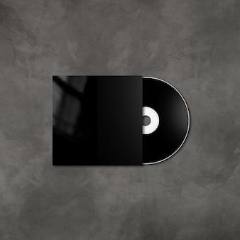 Черный cd - dvd этикетка и шаблон обложки, изолированные на бетонном фоне