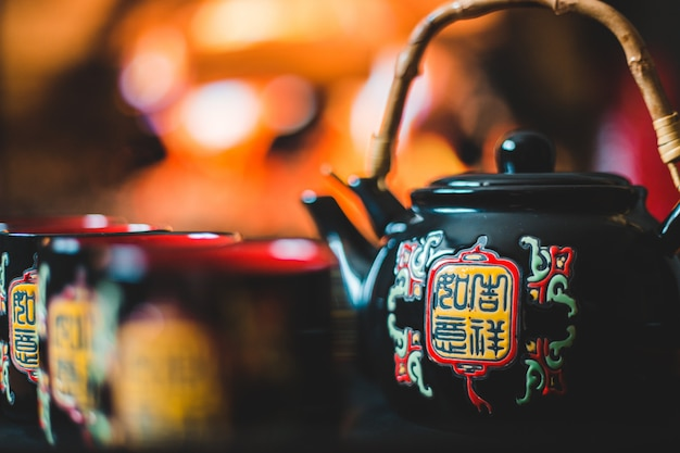 Black ceramic teapot and cups