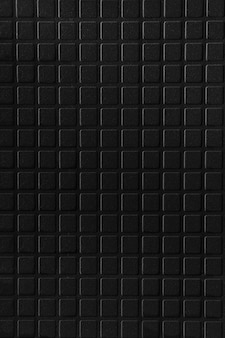 Black ceramic tile brick abstract mosaic background texture