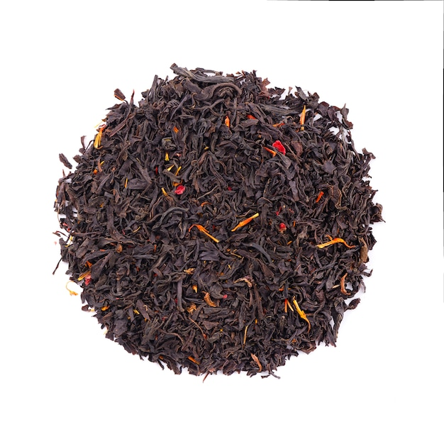 Black ceylon tea with flower petals and bergamot, isolated on white background. top view.