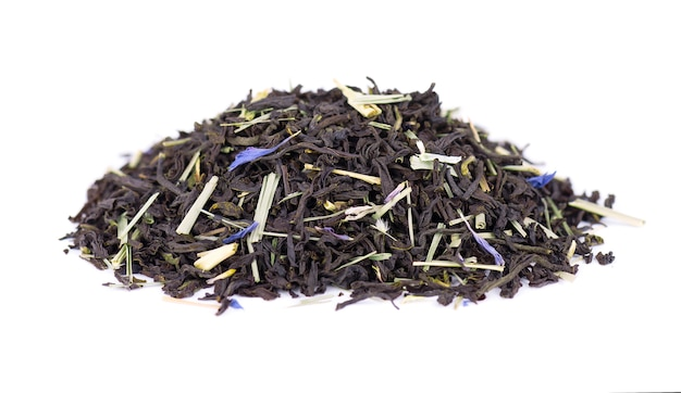 Black ceylon tea with lemongrass and cornflower petals isolated on a white background.