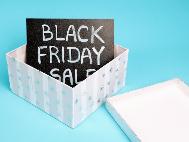 Black chalk board with chalk lettering black friday sale in a gift box