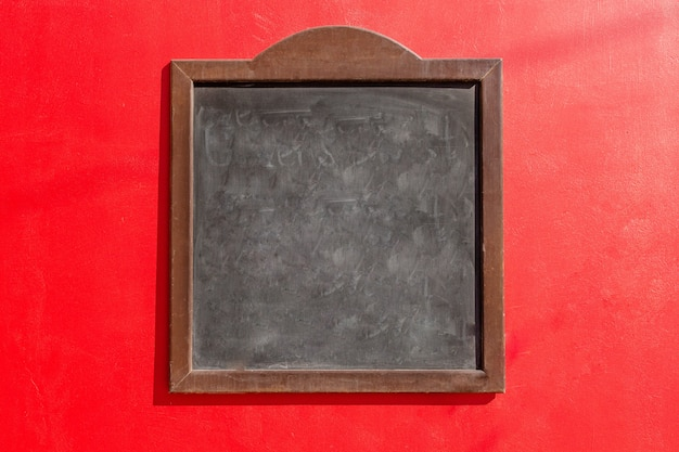 A black chalkboard and a red background