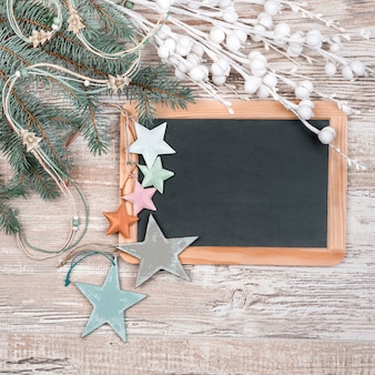 Black chalkboard with winter decorations