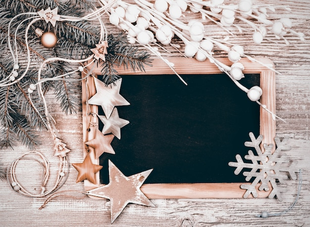 Black chalkboard with winter decorations,