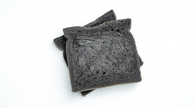 Black charcoal bread on a white background.