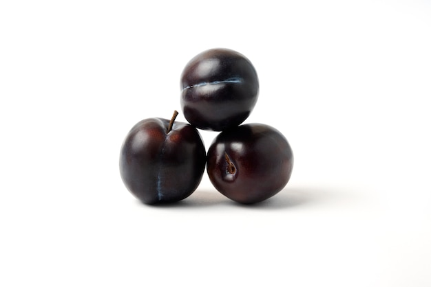 Black cherry plums isolated on white