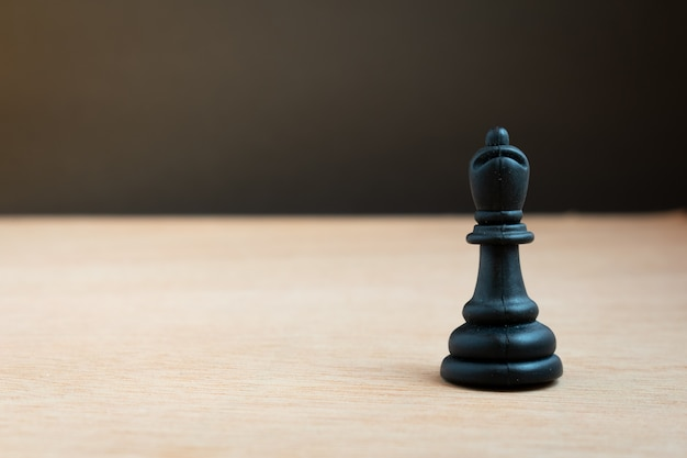 Black chess bishop with black background