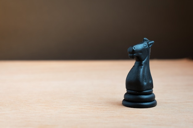 Black chess horse with black background