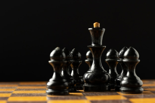 Black chess pieces on chess board.