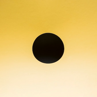 Black circle on a gradient yellow background