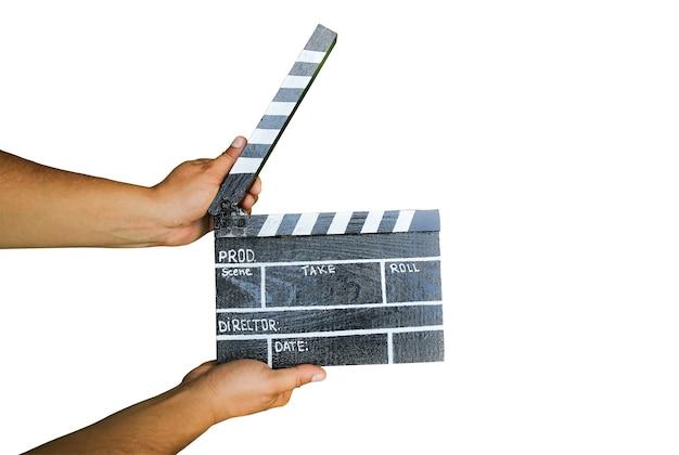 白い背景で隔離の黒いカチンコ。アマチュア映画の監督と。クリエイティブなコンセプト。レトロなビンテージ写真。