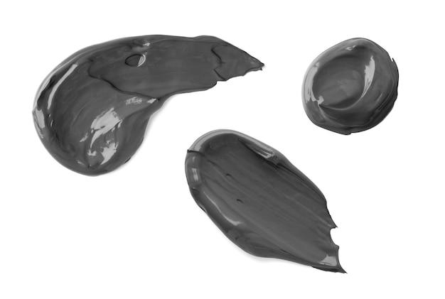검은 점토 마스크 화장품 얼룩 흰색 배경에 고립. 뷰티 크림 텍스처입니다. 스킨케어 제품 얼룩 견본 세트