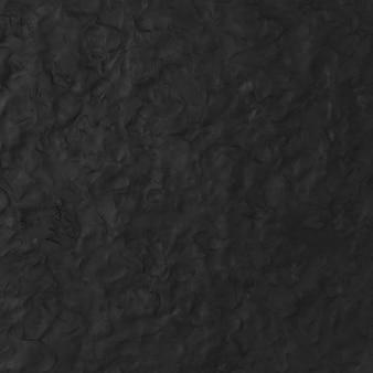 Fondo strutturato dell'argilla nera nello stile minimo di arte creativa astratta di diy