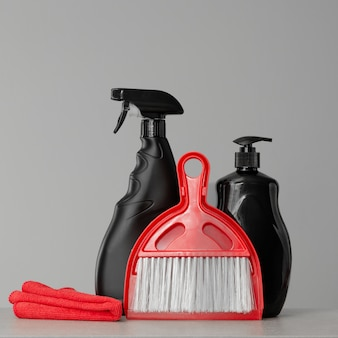 Black cleaning products and red cleaning tools