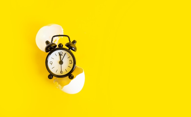 Black clock on a yellow