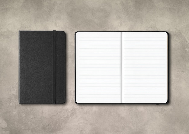 Black closed and open lined notebooks mockup isolated on concrete background