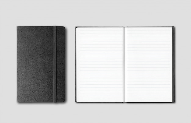 Black closed and open notebooks isolated on grey