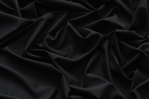 黒の布の背景とテクスチャ、黒の布の抽象的な溝