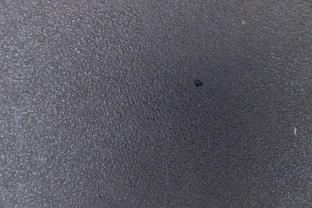 黒い布の表面のテクスチャの背景
