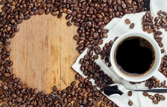Black coffee bean and white cup