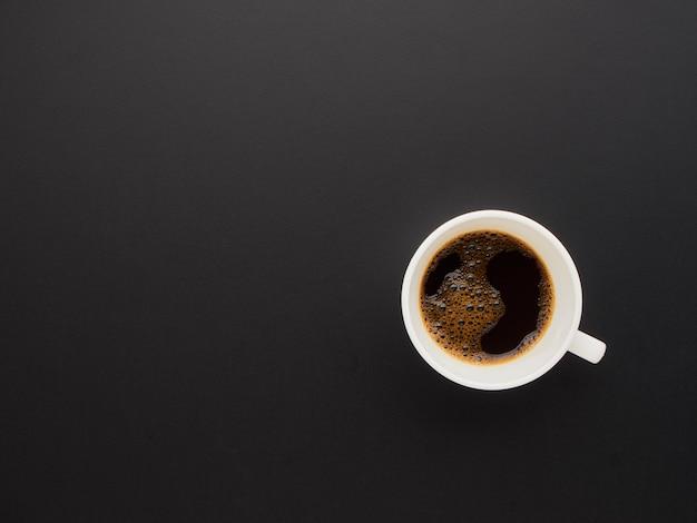 Black coffee on black background