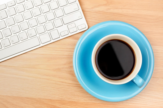 Black coffee in blue cup on brown wooden table