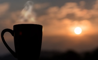 Black Coffee Cup with Evening Light space background