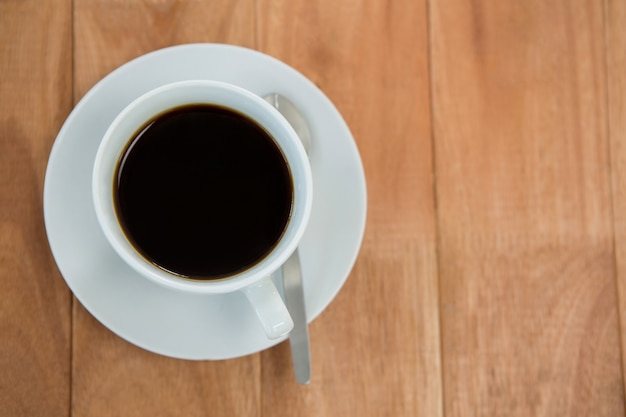 Black coffee served in white cup