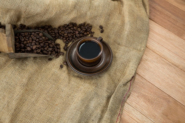 Black coffee with scoop and sack textile