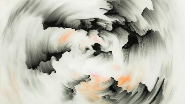 흰색 표면에 원형을 형성하는 검은 색 브러시 스트로크
