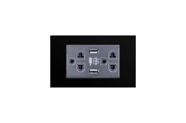 Black color wall outlet ac power plug with usb 5.0v dc output socket for charger isolated on white background.