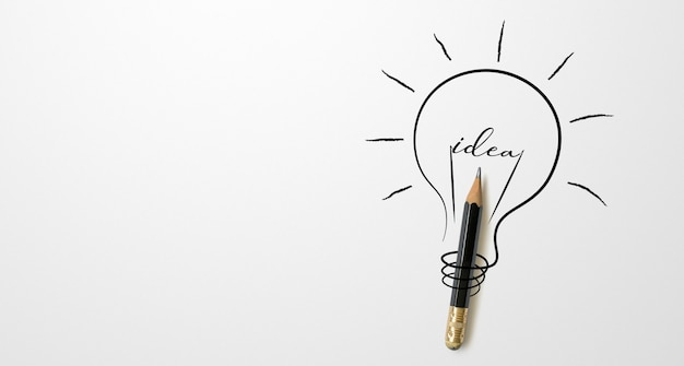 Black colour pencil with outline light bulb drawing and the word idea white background