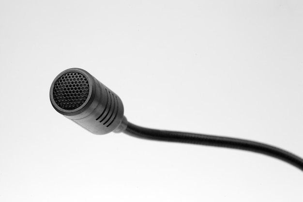 Black computer microphone on a white background.